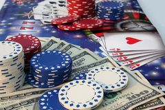 Poker accessories. Poker chips, money and cards royalty free stock photos