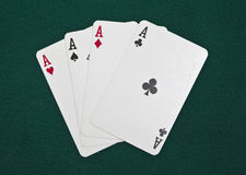 Poker ace. Poker four ace  on a green background Royalty Free Stock Photography