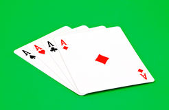 Poker ace. Four poker aces isolated on green background Royalty Free Stock Photography