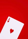 Poker ace of hearts. Ace of hearts on red background Stock Images