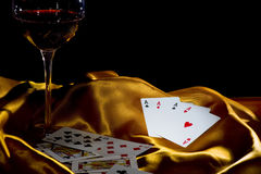 Poker ace and wine Stock Photos