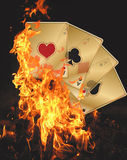 Poker aces gold cards on fire Stock Photos
