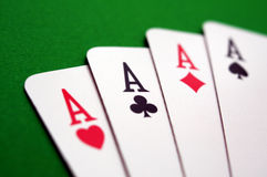 Poker aces. Poker playing cards, four aces over green table Royalty Free Stock Images