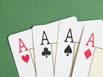 Poker aces. Poker playing cards; four aces over green table Stock Photography