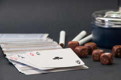 Poker of aces and wooden dice with a ashtray and cigarettes on a Stock Photo