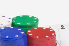 Poker All In. Poker chips and playing cards isolated on white Royalty Free Stock Images