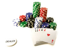 Poker attributes. Color chips cards and dealer button Royalty Free Stock Photos