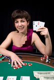 Poker babe. Pretty caucasian girl shows two aces in casino poker stock image