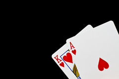 Poker or black jack game. A poker or black jack hand with an ace and a king isolated on black royalty free stock photo