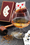 Poker, brandy and smoke pipe Stock Images