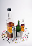 Poker Card. Around different bottles Stock Photography