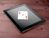 Poker card on digital tablet, poker online Stock Image