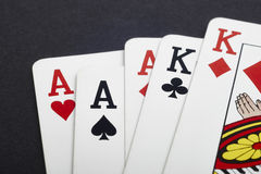 Poker card game with aces and kings full. Black background Stock Photo