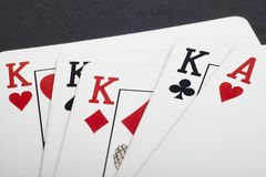 Poker card game with kings and aces full. Black background Stock Photo