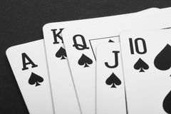 Poker card game with spade straight flush. Black Stock Image