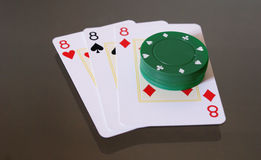 Poker Cards. Three eights and some poker chips stock images