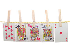 Poker cards. Vintage poker cards hanging on rope - isolated over white background Royalty Free Stock Photo