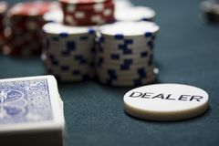 Poker Cards. A deck of cards, a stack of chps and a dealer button Stock Photography