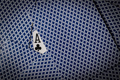 Poker cards with ace of clubs showing Stock Photos