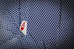 Poker cards with ace of hearts showing royalty free stock photo