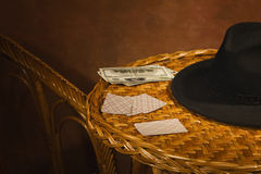 Poker cards, black hat on a table Royalty Free Stock Image