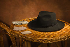 Poker cards, black hat on a table Stock Photography