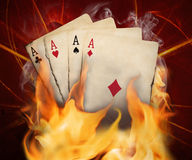 Poker cards burn in the fire Stock Photos