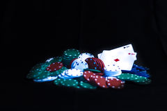 Poker cards and Casino chips isolated. Casino chips, playing cards isolated on black background Stock Image
