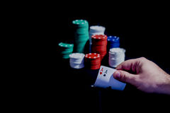 Poker cards and Casino chips isolated. Casino chips, playing cards isolated on black background Stock Photo