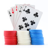 Poker Cards and Chips. Full house aces over sevens poker cards with red, white, and blue game chips; white background stock images