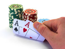 The poker cards with chips. Hand hold the poker cards, chips, white background Royalty Free Stock Images