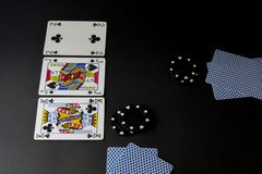 Poker cards and chips on black. Flop, blind and hands o