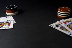 Poker cards and chips on black. Heads up, pair of kings stock image