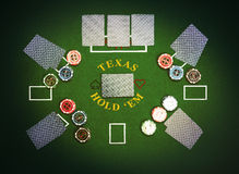 Poker cards and chips lying on green poker cloth Royalty Free Stock Image