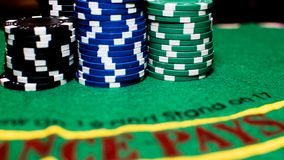 Poker cards and chips of many colors. royalty free stock photos