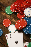 Poker cards and chips. On wooden surface royalty free stock image