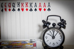 Poker of cards, clocks Stock Photography
