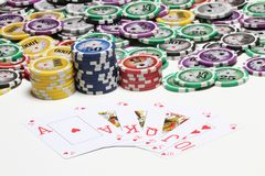 Poker cards and coins Royalty Free Stock Photo