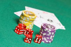 Poker cards, coins and cubes Royalty Free Stock Photos