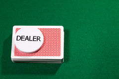Poker cards with dealer chip Stock Image