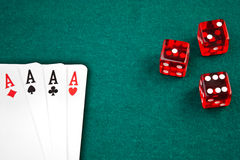 Poker cards and dice on green Royalty Free Stock Photography