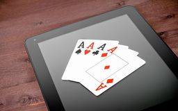 Poker cards on digital tablet, poker online Stock Photography