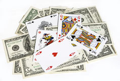 Poker cards and dollar bills. Poker cards on dollar banknotes Stock Photos