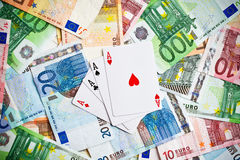 Poker cards and euro banknotes Royalty Free Stock Images