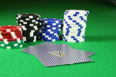 Poker cards face down with poker chips. In the background Royalty Free Stock Images
