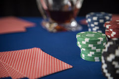 Poker cards and gambling chips on casino table Royalty Free Stock Images