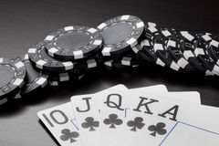 Poker cards with gambling chips - Royal Flush Royalty Free Stock Photos