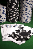 Poker cards on green background Royalty Free Stock Photo