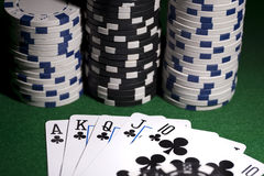 Poker cards on green background Stock Photos