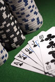 Poker cards on green background Stock Images